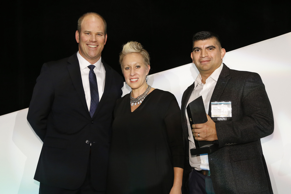 Owners, Cheryl + Luis Stauffer with  Patrick Terrien of Columbus Council on World Affairs.